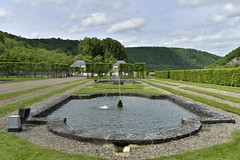 Fontaine et jardins (Flikkersteph -4,000,000 views ,thank you!) Tags: springtime garden waterpool fountain tranquillity landscape nature footpaths reflecting wonderful hills slopes cloudy shadow trees foliage castle hastire wallonia belgium