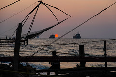Watching the sun go down... (ravalli1) Tags: sunset india nature fishing indian kerala kochi chinesefishingnets fortkochi cheenavala