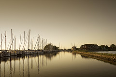 Calm Evening (parkerbernd) Tags: sunset sea reflection port germany boats lumix evening pier harbour jetty peaceful calm baltic yachts mole ostsee fehmarn siling orth gx1