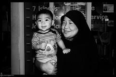 Little man (pineridgephoto) Tags: woman child muslim streetshot