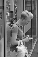 Texting that special someone (Dutch_Chewbacca) Tags: world life street girls summer people urban blackandwhite bw woman white black holland art netherlands girl monochrome beauty dutch canon de women warm europa europe pretty day kei weekend candid nederland citylife streetphotography july saturday sigma sunny streetlife eindhoven streetphoto unposed 9th zwart wit brabant sneaky noordbrabant urbanlife obsessed dlsr 2016 040 straatfotografie 550d gekste unpolished