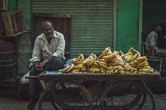 Bananas (Syahrel Azha Hashim) Tags: portrait nikon expression 35mm holiday pc9 stall indian details portraiture india fruits dof market humaninterest olddelhi streetphotography colorimage vacation prime light simple naturallight moment colorful bananas d300s travel syahrel rajasthan streetmarket people street getaway handheld shallow detail