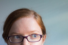 Side eye (lacygentlywaftingcurtains) Tags: selfportrait redhead woman girl female face closeup redhair glasses looking sideways