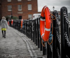 Lifesaver (chrispenfold) Tags: street orange architecture liverpool dock lifebelt albert quay safety cobblestone hanging mersey lifesaver quayside merseyside