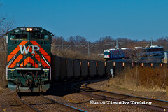 WP and Metro Link in Maplewood (tim_1522) Tags: city railroad light reflection heritage st louis power pacific metro flag sub union rail trains mo missouri fallen transit western link jefferson 1983 coal rapid mopac subdivision emd railfanning railfans sd70ace