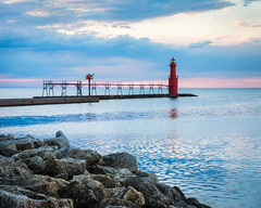 Pure Algoma (PopsDigital) Tags: morning pink light sun lighthouse lake color colour reflection water horizontal wisconsin clouds landscape dawn harbor pier early rocks earlymorning calm lakemichigan ripples wi doorcounty algoma pierlight kewauneecounty billpevlor popsdigital sonyslta77v