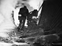 stairway (Dan-Schneider) Tags: street streetphotography blackandwhite bw urban human puddle puddlegram schwarzweiss stairs olympus omdem10 monochrome