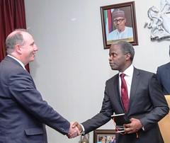 Vice President Pro. Yemi Osinbajo SAN in a handshake with John May Sectary General of Duke of Edinburgh's International Award, during a courtesy visit