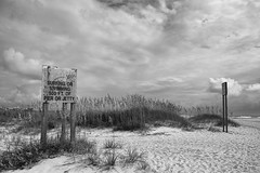 signs- (markitos57) Tags: beach wilmington wrightsville north carolina cape fear river landscapes urban jetty uss nc battleship riverwalk riverfront brunswick atlantic ocean clouds