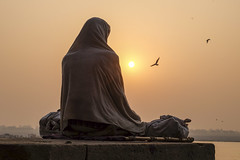 Morning meditatie (Dick Verton ( more than 13.000.000 visitors )) Tags: travel people india man birds sunrise asia sitting sit varanasi meditation seated ganges ghats meditatie