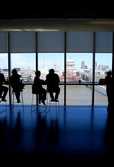 Silhouettes of lunch goers waiting for a table at the Tate Modern restaurant (sooolaro) Tags: england london saint silhouette thames modern river lunch waiting view cathedral tate stpauls silhouettes pauls wait