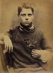 Edward Fenn, bobbin weaver, convicted of stealing clothes (Tyne & Wear Archives & Museums) Tags: poverty wood boy portrait blur face wall shirt youth scarf hair photography clothing interesting eyes chair pattern child hand sad hole arm serious unitedkingdom head mark finger room coat nail grain victorian young wear clothes fabric jail archives trousers jumper unusual pocket tear shoulder theft seated unhappy tyneside crease survival attentive gaol villains stealing woolwich newcastleupontyne fascinating digitalimage prisoners criminals conviction 1873 hardship hardlabour socialhistory northeastengland convictedcriminal neutralbackground sepiaphotograph bobbinwinder wearingapparel criminalsof18711873 1monthprisonterm 31march1873 edwardfenn