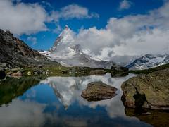 Matterhorn #63 (andertho) Tags: mountain reflection clouds landscape schweiz switzerland pond suisse olympus zermatt matterhorn tarn omd m43 microfourthirds em5ii
