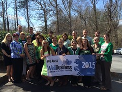 The staff celebrates our Gold WellBusiness distinction on St. Patrick's Day.