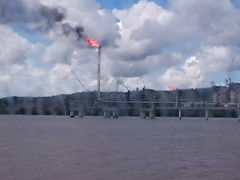 Flares (glennaa) Tags: window ferry clouds australia queensland flares dirtywindow curtisisland qclng