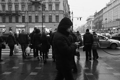 Behind the Crowd (Photographer from Saint-Petersburg) Tags: city people bw against digital 35mm dark movement alone action russia geometry crowd streetphotography single fujifilm streetphoto saintpetersburg crossroad onthestreet x100 fujifilmx100 fujix100 stopmoment