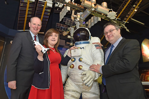 Dr Stephen Farry pictured at Armagh Planetarium with the winner of the United Space School competition, Amy Anderson from Aughnacloy and a student at Southern Regional College's Armagh campus and Brian Doran, SRC Chief Executive.