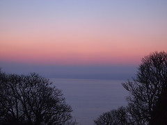 First Light Over Carbis Bay (cycle.nut66) Tags: blue trees light sea orange silhouette st yellow four dawn bay cornwall first olympus pre micro mauve ives thirds carbis epl1 mzuiko