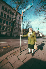 The woman who passes the sentence should swing the spear (Sator Arepo) Tags: portrait sign canon germany munich bavaria traffic wide streetphotography warrior 5d 16mm guardian spear markii 1635mm