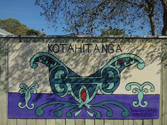 Kotahitanga  Unity (Steve Taylor (Photography)) Tags: blue red newzealand sky streetart tree green art sunshine fence painting graffiti wooden purple symbol unity cream sunny nelson nz mauve southisland maori curve movements kotahitanga