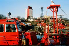 Uto island lighthouse, Baltic sea, Finland (Iurii & Natali) Tags: uto island lighthouse red pilot station boat arhepelgo baltic sea finland suomi may sunrise velvia fuji chrome color vintage analogue classic m42 praktica mtl5 50mm 135 yashicon