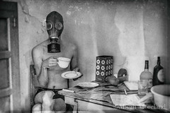Breakfast (micahmoreland) Tags: creepy horror surreal surrealism surrealist conceptual costume wheezer world war 2 ii dystopian scary haunting wet plate grunge texture male toxic death danger gas mask thin skinny abandoned house urbex urban exploration kitchen disturbing comical