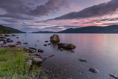 Loch Ness Pastel Sunset. (Gordie Broon.) Tags: lochness sunset pastel rocks coastline meallfuarmhonaidh drumbay scotland schottland scottishhighlands summer ecosse alba caledonia escocia landscape szkocja scenic collines view reflections dores invernessshire inverness inverfarigaig foyers paysage paisaje gordiebroonphotography 2016 nessie calmloch fortaugustus lago lac scozia heuvels canon5dmklll canon1635f4l colinas meer paesaggio sky clouds thegreatglen glenalbyn scaniport geotagged