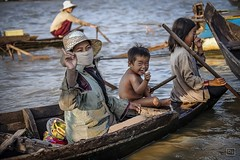 Cambodia - Tonle Sap Lake (Roberto Farina Travel Photography) Tags: portrait people woman lake water face river boat colorful asia cambodia buddhist mother culture moment cheerful mekong reportage tonlesap travelphotography cambogia indocine
