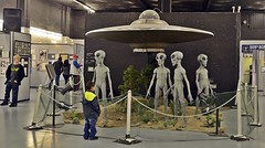 UFO Museum-Roswell, NM-HFF! (A LITTLE COOLER ONLY 93'F TODAY :)) Tags: people man boys display fences statues aliens indoors barrier curious spacecraft roswellnm fencedfriday triptoroswell