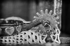 Hearts and Spurs (Mulewings~) Tags: stilllife spurs blackandwhite dof micro macro nikkor40mm 52bestill