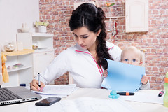 working-mom-with-baby-shutterstock (sarahmepstein) Tags: shutterstock working mother mom baby child worklife balance