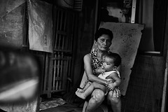 Woman and Child (w28-2016 Philippines) (AST - Photos) Tags: philippines photojournalism street blackdiamond blackwhite bw