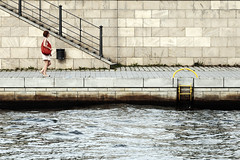 The Urban River (airSnapshooter) Tags: spree river berlin deutschland germany people woman wall brick steps water canoneos6d canonef70200f4l outdoor bag red