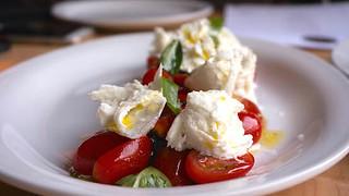 Caprese salad | marinated cherry tomato, mozzarella di bufala, basil pesto