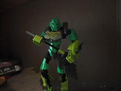Lewa playing the Ax guitar (Toa Banshee) Tags: guitar bionicle pun toa lewa okoto hoogilewakopaka
