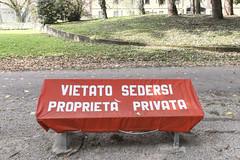 la libertà non è star sopra una panca (Zioluc) Tags: park red urban writing bench private words forbidden cover lodi divieto vietato luciobeltrami