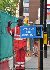 Wait For The Green Man (pjpink) Tags: sign traffic pedestrian safety greenman london city urban england britain uk may 2016 spring pjpink