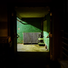 The Room at the End of the Hall (Geoffrey Coelho Photography) Tags: dark room green brick wall architecture architectural interior light dimlylit shadows spooky pearlstreetnightclub northampton massachusetts radiator shadow