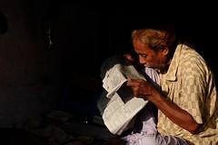 Westerly Sun (Ovhiik) Tags: westerlysun sun light lightandshadow lightshadow yellowlight candid newspaper street streetphotography dhakastreets streettogs fujixt10 fuji peopleofbangladesh
