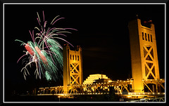 Fireworks_4942 (bjarne.winkler) Tags: river cats 2016 no 11 fireworks 12  standard view from walk embassy suits with tower bridge foreground calstrs building background welcome sacramento ca