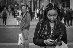 The Illusion (Leanne Boulton) Tags: people monochrome urban street candid portrait portraiture streetphotography candidstreetphotography candidportrait streetlife modernlife young woman female pretty girl face facial expression beauty beautiful braids hair style stylish mobile phone look emotion feeling tone texture detail depthoffield bokeh natural outdoor light shade shadow city scene human life living humanity society culture canon 7d 50mm black white blackwhite bw mono blackandwhite glasgow scotland uk