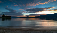 The End of a Beautiful Day (Glen Eldstrom) Tags: britishcolumbia sunset blueskies colourfulsky calm water wideangle painterly kelowna lake lakeokanagan canada landscapelovers landscape calmwaters settingsun