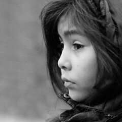 Just a Little Girl (d_t_vos) Tags: street winter portrait blackandwhite bw cold eye girl face hair outside nose eyes waiting cheek coat side watching streetphotography lips teen jacket teenager hood littlegirl staring schwarzweiss resigned leftside alphenaandenrijn noireetblanc alphenadrijn alphen coel stoical dickvos dtvos