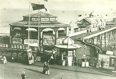 H003672 The Joy Wheel at Hastings pier (pre 1914) (East Sussex Libraries Historical Photos) Tags: road poster pier costume library victorian entertainment pavilion hastings turret edwardian joywheel