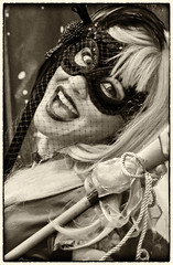 DSC_1573-Edit-1 (craigchaddock) Tags: harleyquinn female sdcc2016 sandiegocomiccon2016 comiccon2016 sandiegocomiccon comiccon cosplay cosplayer crossplay respectcosplayers streetportraiture streetphotography consent monochrome sepia