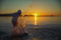the age of kineticism~ Sardinia (~mimo~) Tags: sunrise sardinia italy water sun mediterranean sea boy hood teenager drops frozen hoodie motionfreeze kick splash island europe travel light color outdoor beach pelosa action freedom ripple