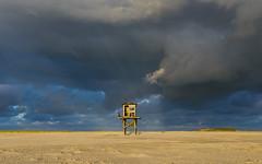 squall passes by (hein van houten) Tags: squall sunlight sun sanddunes sand vliehors eveningskies coast northseacoast vlieland