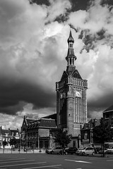 Belfry under the clouds (Explore on July, 14th 2016) (MathayJL - Offline for 2 days) Tags: noiretblanc canon eos 1100d sigma bw blackandwhite city street bailleul nordpasdecalaispicardie france flandre flanders rue ville beffroi belfy cityhall mairie cloud clouds nuage nuages cloudy nuageux clock horloge cars voitures carpark parking trees arbres sky ciel cityscape paysageurbain bnw contrast mto weather tour historic vehicles storm tempte explore outside sigma1750 digital blackwhitephotos