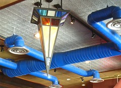 looking up (muffett68 ) Tags: ventilation pipes blue industrial stainedglass lightfixture lookingup burlington