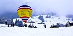 Chteau-d'x balloon festival (somabiswas) Tags: snow nature landscape switzerland vaud hotairbaloon baloonfestival chteaudoex